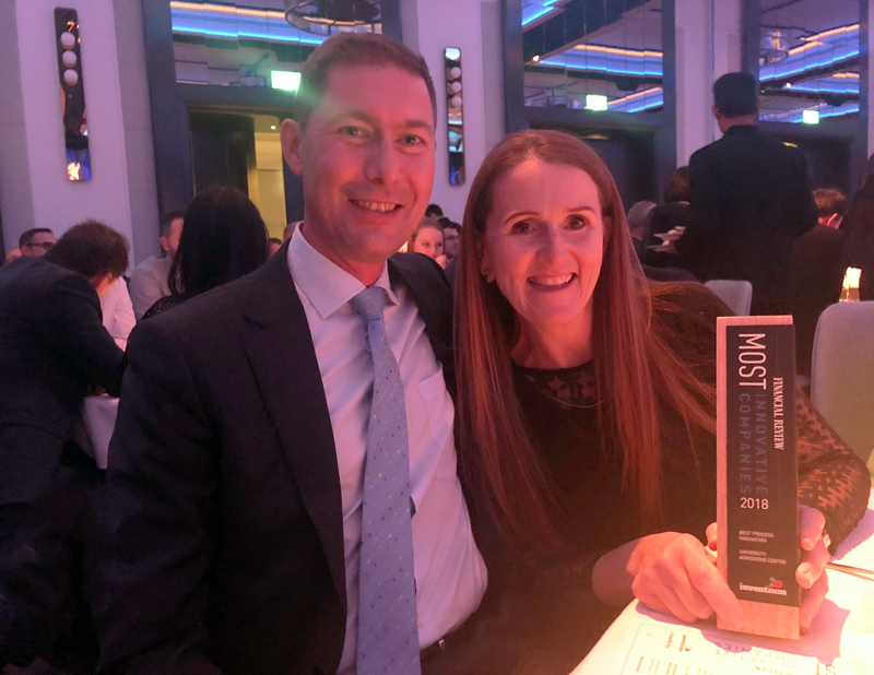 Dr David Christie, Managing Director at UAC, and Kim Paino, General Manager proudly holding our AFR award