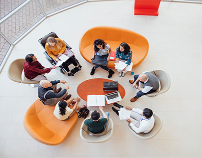 Student sit around a table collaborating