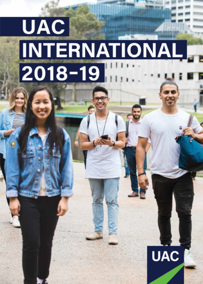Cover of the publication UAC International 2018-19 which depicts a small crowd of young people standing outdoors smiling to camera