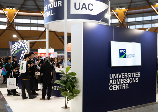 High school students at the UAC stand at a careers expo