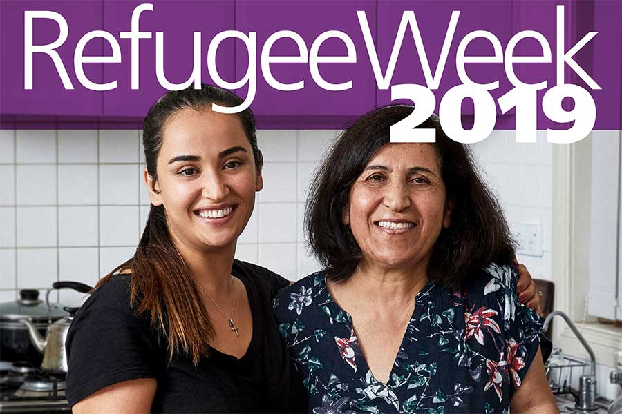 Refugee Week 2019 poster showing two women, possibly mother and daughter, in a kitchen smiling to camera