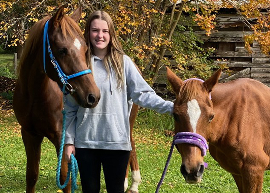 Year 10 student Mackensie Daley with her two horses